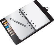 空白笔记本计划程序 库存照片