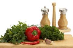 空白背景新鲜的香料的蔬菜 免版税库存图片
