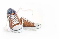 空白背景棕色的鞋子 免版税库存图片