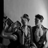 空白背景的三名马戏团演员 免版税库存照片