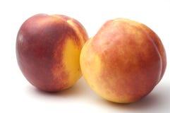 空白背景的油桃 免版税库存照片