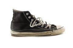 空白背景脏的查出的老的运动鞋 免版税图库摄影