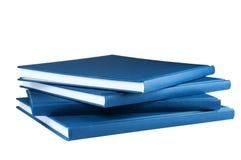 空白背景蓝色四查出的记事本 免版税库存图片