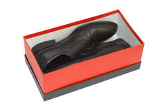 空白背景黑匣子红色的鞋子 库存图片