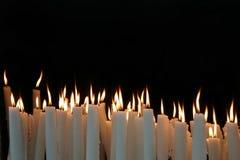空白背景黑色的烛光焰 免版税图库摄影
