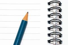 空白蓝色空的记事本铅笔环形螺旋 图库摄影