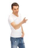 空白衬衣的人指向他的手指的 库存照片