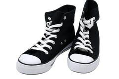 空白黑色的运动鞋 库存照片