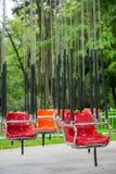 空的五颜六色的摇摆的椅子转盘 免版税库存图片