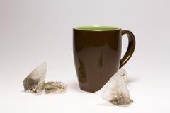 空的杯和茶包 图库摄影