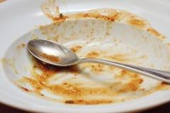 空的碗和匙子 库存照片