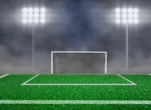 空的足球场和聚光灯与烟 免版税库存照片