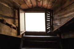 空的顶楼窗口有白色背景 库存图片