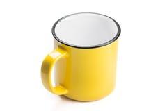 空的黄色咖啡杯 库存照片