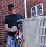 空调安装工服务的浩劫系统 免版税库存图片