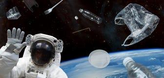 空间残块,行星地球 在空间的塑料残骸 美国航空航天局装备的这个图象的元素 图库摄影