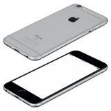 空间灰色苹果计算机iPhone 6s大模型说谎表面上顺时针 图库摄影