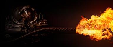 空间装甲和火焰喷射器的人 库存图片