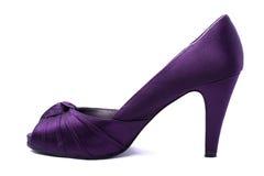 穿上鞋子妇女 免版税库存照片