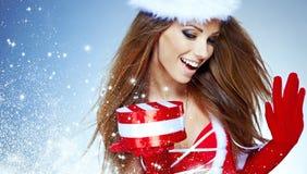 穿与圣诞节的女孩圣诞老人衣裳 图库摄影