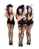 穿兔宝宝服装的三个性感的女孩 库存照片
