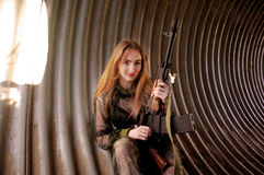 穿军服的女孩 免版税图库摄影