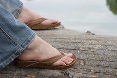 穿凉鞋的英尺 库存图片