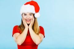 穿圣诞老人帮手服装的正面妇女 免版税库存图片
