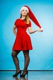 穿圣诞老人帮手服装礼服的妇女 库存照片