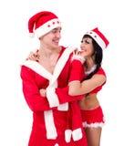 穿圣诞老人衣裳的夫妇 免版税库存照片