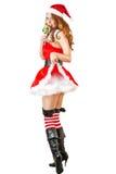 穿圣诞老人衣裳的性感的圣诞节妇女 免版税库存图片