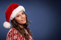 穿圣诞老人衣裳的性感的女孩画象 免版税图库摄影