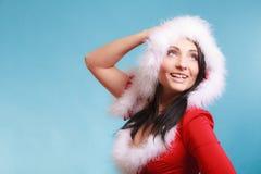 穿在蓝色的画象妇女圣诞老人服装 图库摄影