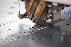 穿孔工业机器的金属 图库摄影