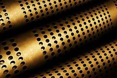穿孔的金属管子 免版税库存图片
