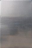 穿孔的铝板料为作为背景的使用 库存图片