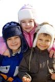穿戴的4孩子冬天 库存照片