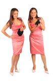 穿晚礼服的二名同样妇女在工作室 图库摄影