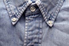 穿的牛仔布老衬衣 免版税库存图片