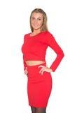 穿着一条红色裙子的美丽的性感的少妇 库存照片
