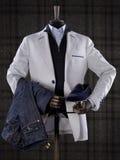 穿着典雅的男性衣服的钝汉隔绝在方格的背景 免版税图库摄影