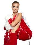 穿着圣诞老人服装的妇女 免版税库存照片