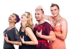 穿着异性服装滑稽的三个的男人和一名妇女 库存图片