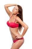 穿着桃红色比基尼泳装的妇女纵向 库存照片