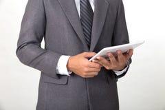 穿着灰色衣服u的年轻亚洲起始的企业家商人 免版税库存照片