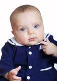 穿着蓝色衣服的女婴 图库摄影
