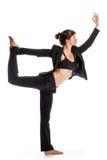 穿着西装的瑜伽姿势的妇女。 免版税库存照片