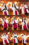 穿红色礼服和白色外套的时兴的夫人室外在与城市的都市风景在背景中点燃 全长纵向 免版税库存图片