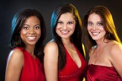 穿红色礼服的小组妇女 免版税库存照片