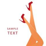 穿红色高跟鞋的美好的女性腿 库存图片